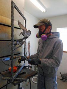 """Savides applying patina to""""Air Africa"""" - Savides Sculpture Sculpting Process Casting Process"""